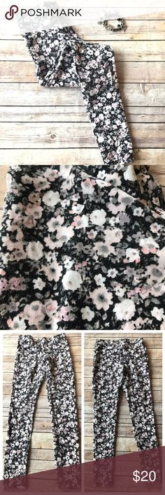Express Floral Pattern Leggings These leggings will be perfect for winter into spring weather! You can wear them now with a sweater or during the spring with a tank top! Black base with gray, pink, and cream flowers. Express Pants Leggings