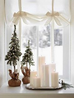 simple christmas decor with candles and Christmas trees