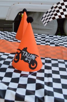 Motocross dirt bike birthday party hats - my sister is so crafty!