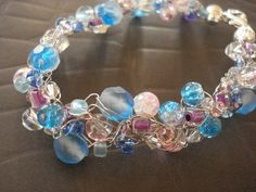 Definitely going to try this...http://www.allfreecrochet.com/Crochet-Videos/How-to-Make-a-Crochet-Jewelry-Wire-Chunky-Bracelet/ct/1