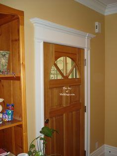 add taller molding to front door andbpaint white keep door oak more. Black Bedroom Furniture Sets. Home Design Ideas