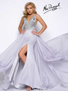 Sleeveless, platinum, plunging V, fully beaded bodice, with sexy high slit chiffon skirt with satin lining and open back.