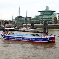 Dolphin passing Hermitage Moorings during the Annual Thames Barge Driving Match on Saturday.