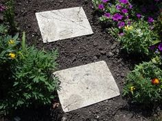 Garden Stepping Stones  Making your own stepping stones is easy and fun and can be very inexpensive to make. Kids can help with adult supervision and wearing latex gloves. What is nice is how versatile this project is. You can buy stepping stone molds, but you can also use so many things that you already have at home to make one that is just the size and shape that you want.            We used old 9 x 13 cake pans. Other people on family crafts at about.com used foil pans, pizza boxes, flower pot bo...