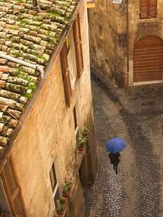 A Touch of Blue in stark contrast to the cobblestone streets and crumbling 15th century buildings of the old city of Orvieto in Umbria, Italy