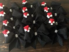 Christmas Santa cheer bows Saw these on Pinterest, so like any good cheer mom...I rush out to buy the supplies and make one for all our girls
