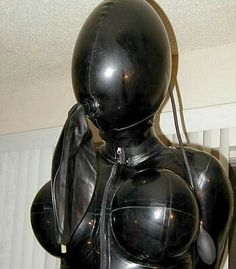 http://rubberdollowner.tumblr.com Simply gorgeous with the inflatable hood and though you can't see it, possible arm binder!! Don't you love breath play?
