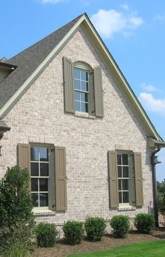 The side of a brick home can be just as dramatic as the front. Add a segmental arch and brick sill to the windows along with a soldier course header. http://insistonbrick.com/