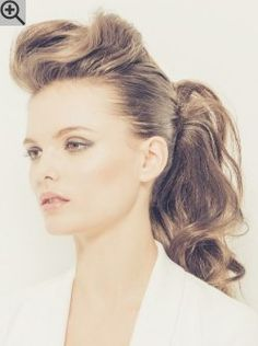 Hair styled up in a messy ponytail. Featuring a stylish quiff and lots of texture in the tail.