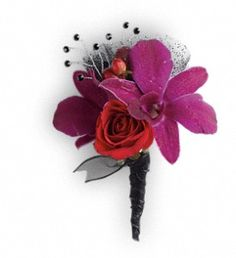 Shake it up with the Celebrity Style boutineer version of purple dendrobium orchids, chic red sweetheart roses, and black rhinestones.  All that's left is the red carpet. TPR07-1A