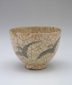 Kyoto ware tea bowl with design of swallows  19th century      Edo period or Meiji era     Stoneware with cobalt decoration under crackled glaze  H: 8.9 W: 12.7 cm   Kyoto, Japan.