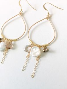 CALYPSO - 14k gold fill hoop dangle earrings with hand wire wrapped freshwater pearls, rutilated quartz, pyrite beads and 14k gold fill chain accents. Dual silver and gold colors make the CALYPSO earrings a staple piece long after your wedding day!  - 1  hoop diameter - 2.5 drop - lightweight  1 pair ready to ship.