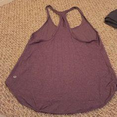 Lululemon tank Lululemon purple/plum yoga racer back. Light tank, lightly worn. Great condition! lululemon athletica Tops Tank Tops