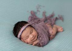 Cette photographe capte les sourires angéliques des nouveaux-nés                                                                                                                                                                                 Plus