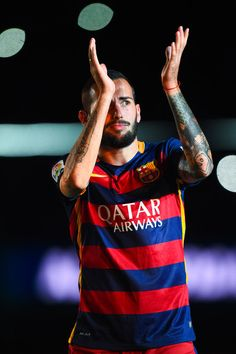 Aleix Vidal of FC Barcelona waves during the team official presentation ahead of the Joan Gamper trophy match at Camp Nou on August 5, 2015 in Barcelona, Catalonia.