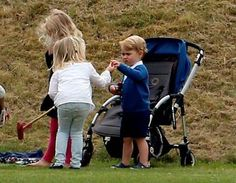 Prince George, as the Duke of Cambridge and Prince Harry take part in a charity polo match at Beaufort Polo Club in Tetbury, Gloucestershire. Steve Parsons/PA Wire.