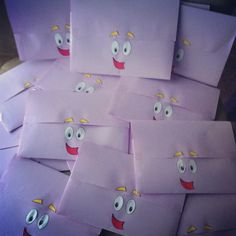 DIY envelopes out of purple paper to make backpacks face on the back side. Made by me with a template arlenedanielle_ on instagram. Dora party idea '