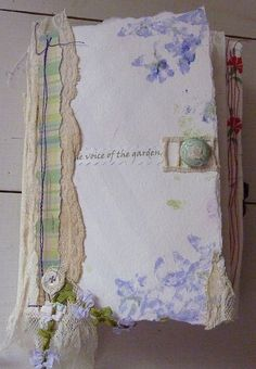 Journal page w/ fabric, lace & embellishments on what looks like watercolor paper ~ such pretty layers by Bunty B