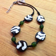 Batik disk beads and green recycled glass beads were handcrafted in Ghana and are strung on this 8.5-inch necklace with adjustable length.