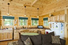Love all the kitchen windows!  Coventry Log Homes | Our Log Home Designs | Cabin Series | The Adventurer