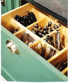 I like this idea!  I'd never have to worry about my stacks of spoons and forks falling over in the silverware tray anymore.  Just put a little cork at the bottom of each compartment to protect the wood.