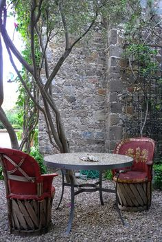 A pair of traditional Mexican leather chairs - Via Remodelista