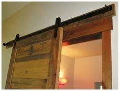 barn door track hardware with reclaimed wood door