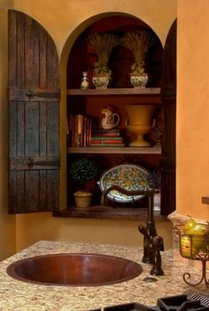 Typical colors for a Tuscan kitchen - warm terracottas and natural browns or muted shades with Meditteranean blues. This site gives guidelines for a Tuscan style kitchen Tuscany Kitchen, Rustic Kitchen, Kitchen Sink, Kitchen Cabinets, Kitchen Shelves, French Country Kitchens, Country French, Country Style, Spanish Style Homes