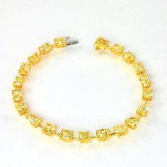 Fancy Intense Yellow diamond bracelet (12.26 Ct TW)