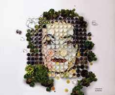 :With his pilot project 'El Banquete', graphic designer and illustrator Martin Satí and his students were using fruits, vegetables and small glasses arranged in rows to create a large scale portrait.
