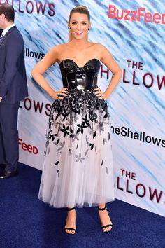 he actress wears a Carolina Herrera bustier gown and Christian Louboutin heels at the New York premiere of The Shallows.