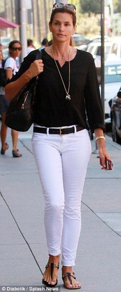 Pinned for a great look and growing up with Cindy! Seasonless style: The mother-of-two looked chic in a black blouse and white skinny jeans, . White Jeans Outfit, White Skinny Jeans, White Skinnies, White Pants, Black Blouse Outfit, Black Jeans, Fashion Mode, Look Fashion, Womens Fashion