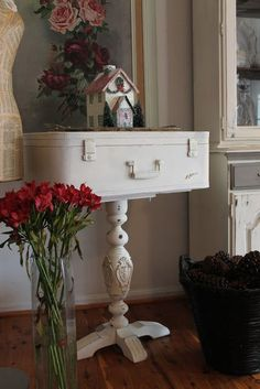 Table base with vintage suitcase painted in Old White.  So cute!