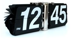 "A Giant Flip Clock... and far more...    Our Black Giant Wall Flip Clock will be the focal point of any room with its quiet flipping numbers and unique design reminiscent of years past. This uniquely large flip clock measures a whopping 13"" x 5"" x 4"" and is wall mountable, or it can rest on any flat surface such as a desk, table, or mantle. The clock operates on one D-size battery, not included.    Check it out: http://www.littleclockshop.com/index.html"