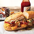 Shrimp Po Boy. The paper-thin crust and pillowy crumb of a New Orleans—style French roll is essential to this classic sandwich—as is Crystal hot sauce.