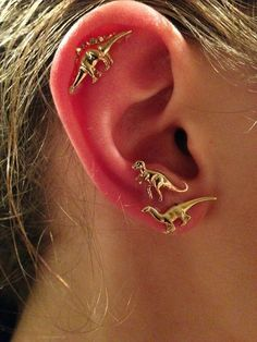 Single Helix with Double Piercing | 28 Adventurous Ear Piercings To Try This Summer  The top dinosaur is super rad!