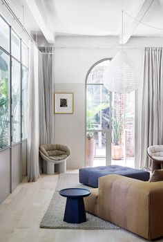 A pair of neighbouring apartments combined into one | Belle Brick Arch, Traditional Doors, Bistro Chairs, Level Homes, Timber Flooring, Apartment Interior, Furniture Inspiration, Living Area, Living Rooms