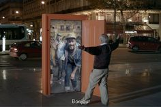 Company SNCF placed brightly colored doors in public places around Paris that enabled people to...