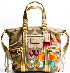 Coach-personally I think this is gaudy and ugly as all hell! It looks like a Coach knockoff, or like Coach is changing their image to that of Betsy Johnson!