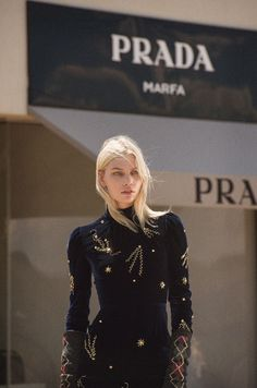 Appearing on the fall-winter 2016 cover of ODDA Magazine, model Aline Weber poses in Marfa, Texas. The Brazilian beauty wears a brocade Prada dress with a laced-up corset. In the accompanying spread, Aline poses at the Prada Marfa installation lensed by Marc Pilaro. Located off the U.S. 90 Highway, the desert setting serves as a...[Read More]