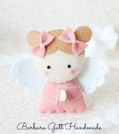 Barbara Handmade...: filc (Cute angel idea made from felt, beads and a little sewing. Love to make one and then frame it for a little girl's room.)