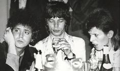 Lou Reed, Mick Jagger and David Bowie hanging out together at Café Royale, 1973.