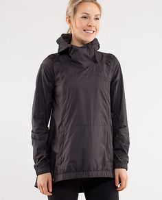 Lightweight rain jacket that folds up into a compact pocket to travel or stuff in your running gear on a variable weather day