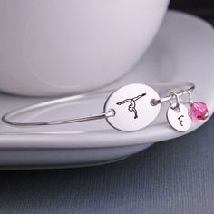 The stainless steel oval is engraved with a gymnast and measures inch across. Also available in gold filled. Shop unique and personalized jewelry gifts at Love, Georgie today! Mom Jewelry, Custom Jewelry, Unique Jewelry, Handmade Jewelry, Jewelry Necklaces, Engraved Gifts, Engraved Jewelry, Personalized Jewelry, Sterling Silver Cross Pendant