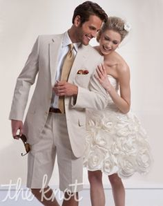 Kleinfeld Men   Two-button suit features sand corded cotton, notched lapel, and shorts.