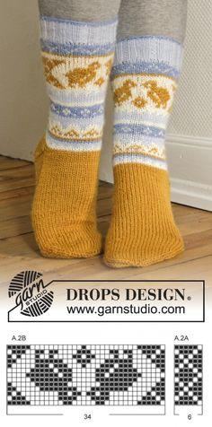"DROPS Easter: Knitted DROPS socks with Norwegian pattern in ""Karisma"". ~free knitting sock pattern by DROPS Design Knitting Patterns Free, Free Knitting, Free Pattern, Crochet Patterns, Drops Design, Crochet Socks, Knitting Socks, Knit Crochet, Crochet Design"