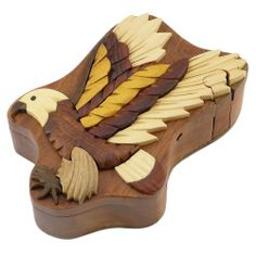Eagle Handmade Carved Wood Intarsia Puzzle Box by The Handcrafted. $29.00. Color variations come from different woods and stains. Approximately 5.75 x 4 x 2.25 inches (LxWxH). Unique collector's box is handcrafted by Vietnamese artisans. Sliding key unlocks box, then lid slides off to reveal inner secret compartment. Natural Wood. You'll find these decorative handmade wooden puzzle boxes to be a thoughtful gift and perfect for collectors. They come in a wide variety o...