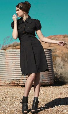 Cute black dress! Possibly military inspired?