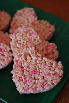 Pink heart rice crisspy treats. Just add pink sprinkles to regular mix and then cut out with heart shaped cutter. I think I could really pull this off.