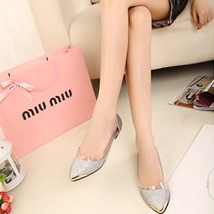 http://ccrrents.com/hepburn-wind-spring-2013-new-european-and-american-metal-pointed-flat-shoes-with-a-single-transparent-crystal-glitter-shoes-p-6374.html